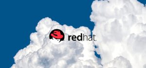 Cloud background with red hat logo